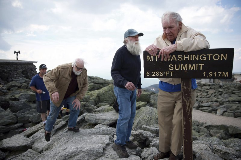 Guy Gosselin, left (wearing glasses), makes his way to the summit of Mount Washington June 1, to reunite with Gerry Wright, center, and Harold Addison, right.