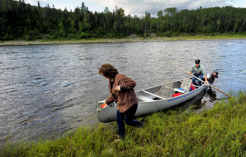 Cathie Pelletier and her brother, Vernon, come ashore on the bank of the St. John River.