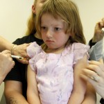 A child is vaccinated in Vermont in 2012. A 1999 MaineCare expansion made it more likely that Maine kids would get preventive care such as vaccines.