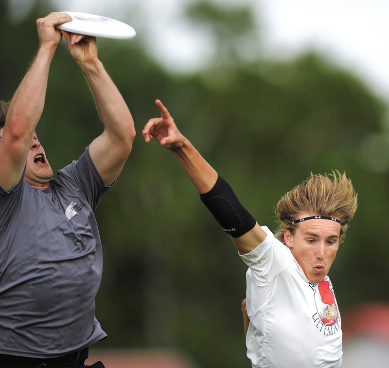 Jacob Brady of Cape Elizabeth, right, has the disc sail over his head. USA Ultimate, the national governing body, may select Portland as the site of the Northeast Regional next May.