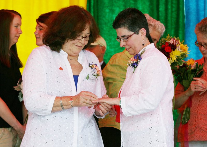 Rose Larkin, left, puts a ring on Deb DeTuccio's finger June 15 during a mass wedding held in Deering Oaks in Portland as part of the Southern Maine Pride Festival. The highest court in the land has struck down part of a law that prevents the federal government from recognizing the marriages of couples married in states like Maine that don't discriminate.