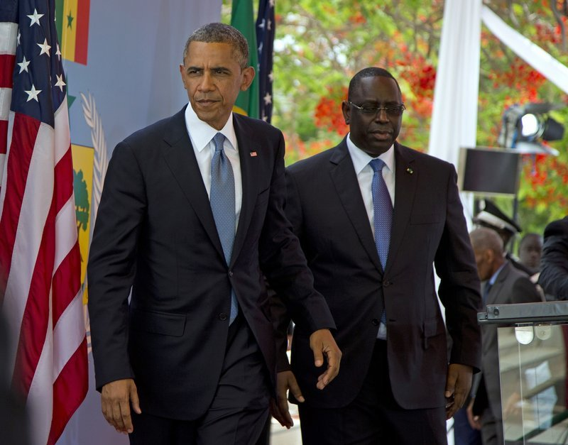 President Obama and Senegalese President Macky Sall leave after a news conference in Dakar, Senegal, on Thursday. Obama is visiting Senegal, South Africa and Tanzania.