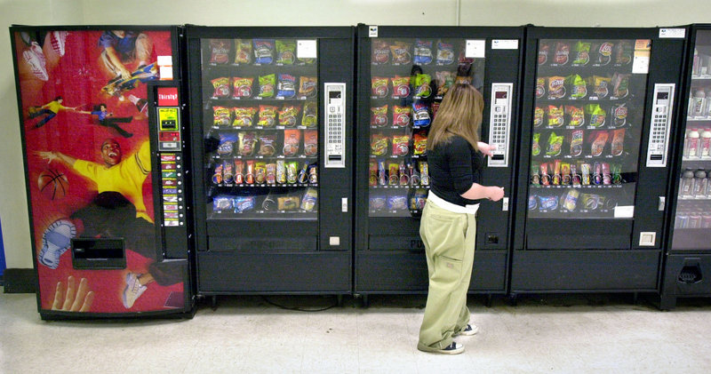 The new federal rules on snacks sold at schools take effect in the 2014-15 year.
