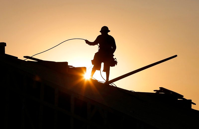 A construction worker in Queen Creek, Ariz., tries to beat a western U.S. heat wave by starting at sunrise. Temperatures in Arizona have hit 118 degrees and even northern Utah is expected to break the triple-digit mark.