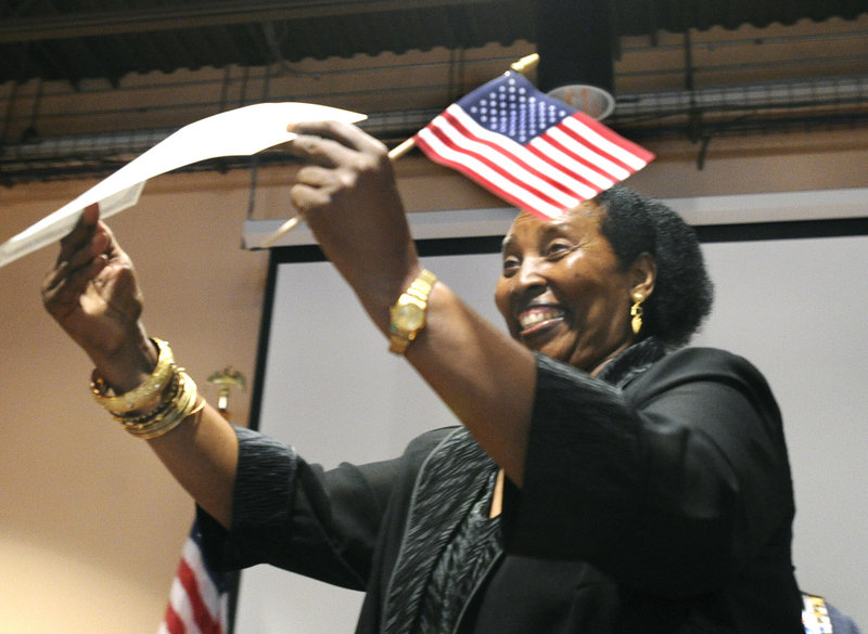 Mariyamu Tausi, a Portland resident originally from the Democratic Republic of the Congo, displays her certificate of citizenship at the Lewiston Regional Technical Center.