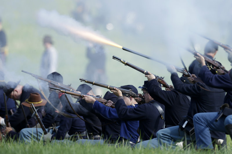 Union re-enactors participate in a battle during ongoing activities commemorating the 150th anniversary of the Battle of Gettysburg, the pivotal battle of the Civil War, on Friday at Bushey Farm in Gettysburg, Pa.