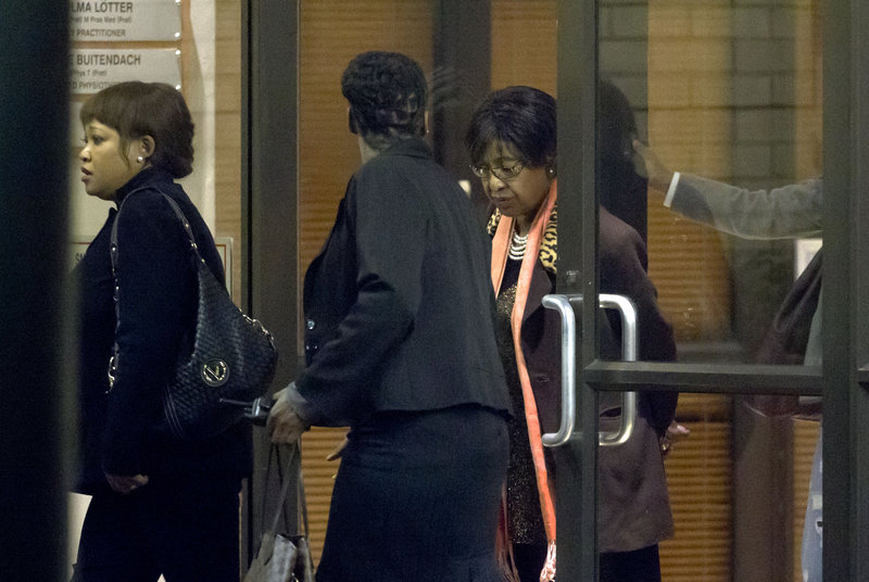 Winnie Madikizela-Mandela, right, departs after paying a visit to the hospital where her former husband Nelson Mandela is being treated in Pretoria, South Africa.