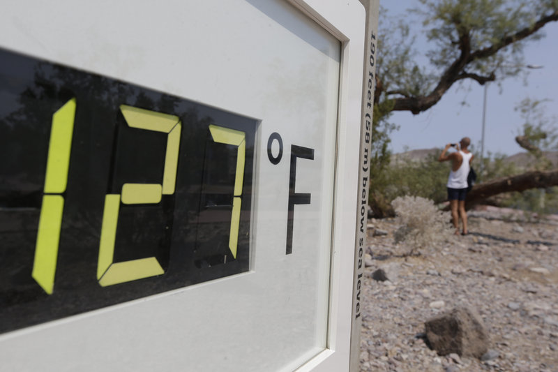 A thermometer shows the temperature in Death Valley National Park, Furnace Creek, Calif., Friday.