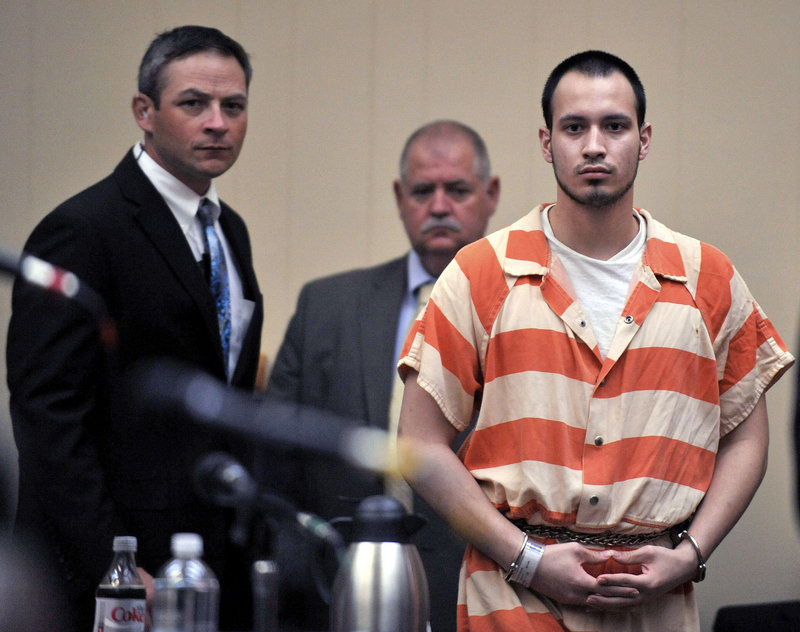 Pvt. Isaac Aguigui walks into the courtroom during a preliminary hearing at Long County Superior Court in Ludowici, Ga., in 2012.