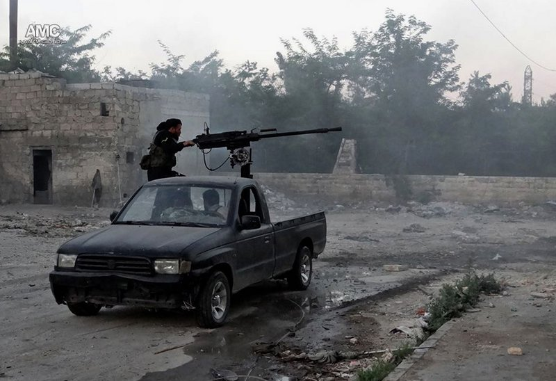 A Syrian rebel fires at soldiers loyal to President Bashar Assad in Aleppo. Experts see little appetite among European nations for adding more weapons to the bloody civil war.