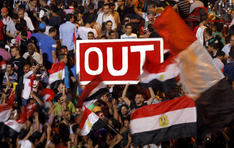 Egyptian protesters hold a banner in Tahrir Square during a demonstration against Egypt's Islamist President Mohammed Morsi in Cairo on Sunday.