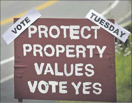 A political sign stands on Spring Street in Freeport on Monday in advance of Tuesday's school election.