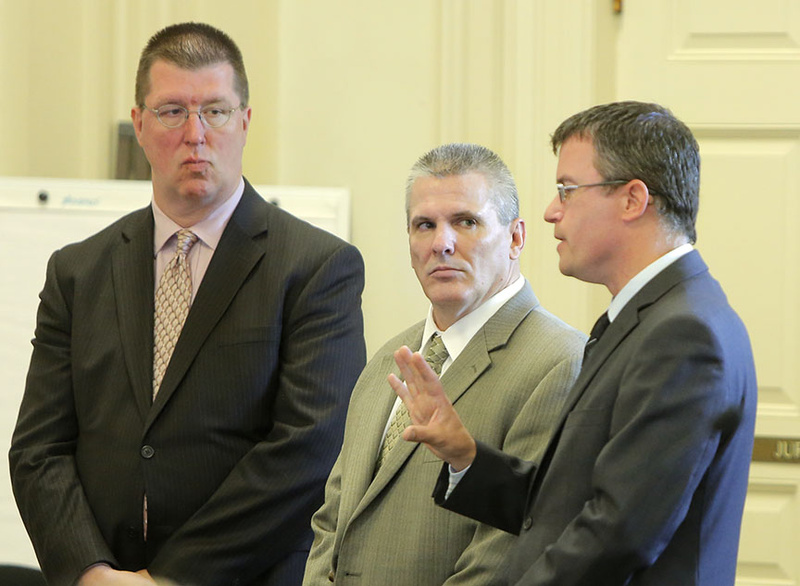 Michael Swenson, center, pleaded guilty Friday in York County Superior Court in Alfred to killing his friend Robert White in Old Orchard Beach in April 2012. With Swenson are his lawyers Joseph Mekonis, left, and Randall Bates.