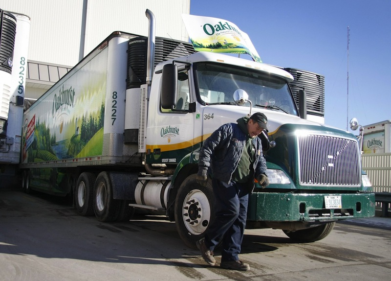 In this 2011 file photo, an Oakhurst truck driver prepares to head out for deliveries. New U.S. safety regulations requiring truckers to work shorter shifts may cut productivity, worsen a driver shortage and boost freight costs for the $8.4 trillion in goods hauled each year by American big rigs.