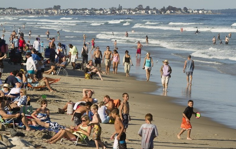 People congregate at Ogunquit Beach, one popular destination for tourists visiting Maine.
