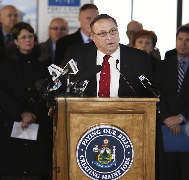 In this January file photo, Gov. Paul LePage holds a press conference at the University of New England's College of Dental Medicine. LePage said Tuesday, July 2, 2013 he's running for re-election.
