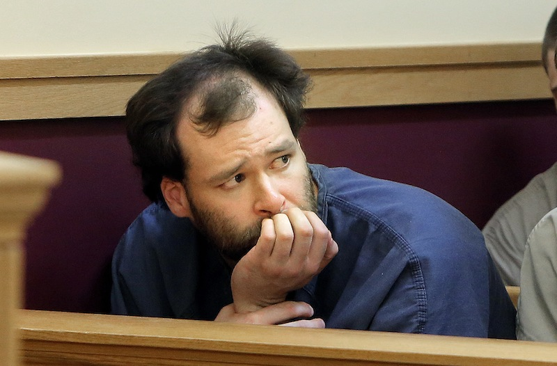 Brian Morin looks toward co-defendant Bryan Wood, (not pictured) as the two Lewiston men were arraigned Monday, May 13, 2013, in Lewiston District Court on three charges each of arson.