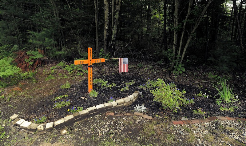 A roadside memorial for Steven Delano, seen Saturday, June 29, 2013, stands at the corner of Holmes and Payne Road in Scarborough where he was killed in a car crash in 2010.