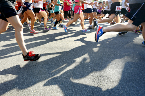 Competitors run down Bow Street at the start of the L.L.Bean Fourth of July 10K Road Race in Freeport.