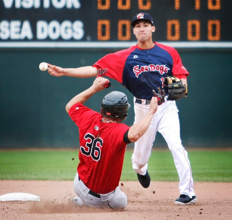 Portland Sea Dogs shortstop Derrik Gibson (15) forces out New Britain Rock Cat Josmil Pinto (36) at second base and makes the throw to first for a double play in the eighth inning at Hadlock Field in Portland on Monday, July 8, 2013.