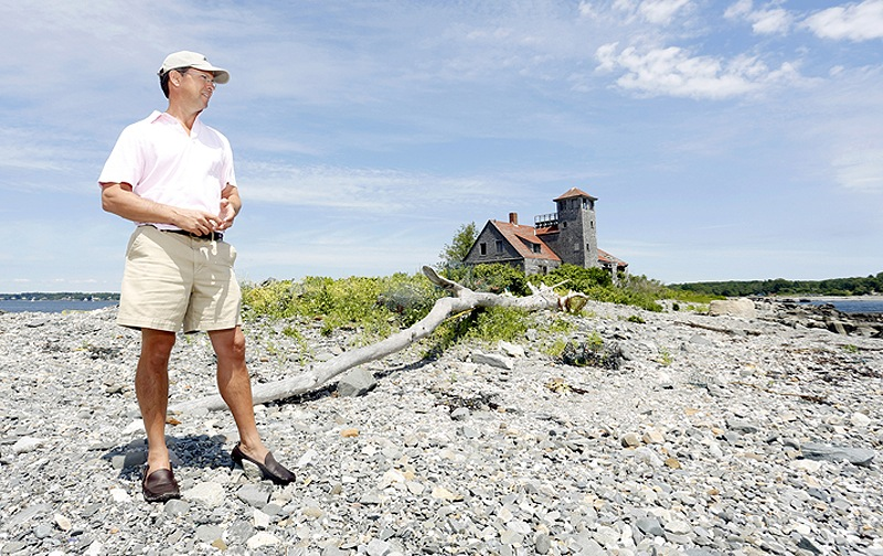 Sam Reid, president of the Wood Island Life Saving Station Association, formed the nonprofit group in hopes of getting the town of Kittery Point to transfer ownership of the building, in background, so it could be restored and turned into a museum.