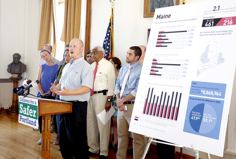 Portland City Councilor David Marshall speaks during a news conference about making marijuana legal in Portland, at Portland City Hall on Monday. On the board to the right are statistics depicting the disparities between blacks and whites in the arrest rates on marijuana possession charges.