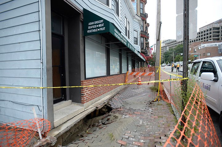 The sidewalk in front of the Hong Kong Market on Congress Street in Portland was closed after it was damaged by a water main break on Monday.