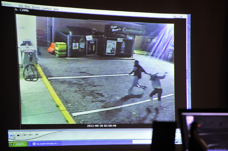The prosecution in Eric Gwaro's attempted murder trial aired a video from a Big Apple store showing a man pulling a woman across the parking lot to behind the Cumberland Garage in Portland.