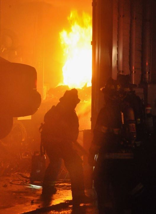 Portland firefighters work to extinguish a fire at 324 Warren Ave. on Wednesday night. The building is owned by Castle Rock Investments in Falmouth.