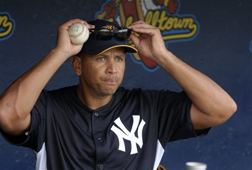 In this July 15, 2013, photo, New York Yankees third baseman Alex Rodriguez heads out to batting practice before a Class AA baseball game with the Trenton Thunder. Rodriguez is one of about 20 major league players who are being investigated for their involvement with Biogenesis, a now-shuttered anti-aging clinic in South Florida.