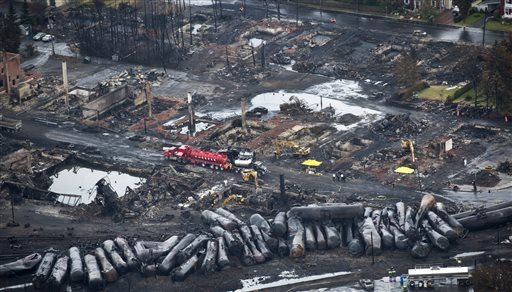 Workers comb through the wreckage Tuesday in Lac-Megantic, Quebec.