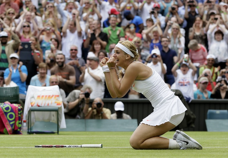 Sabine Lisicki of Germany after beating Serena Williams of the United States in a Women's singles match at the All England Lawn Tennis Championships in Wimbledon, London, Monday, July 1, 2013. (AP Photo/Alastair Grant)