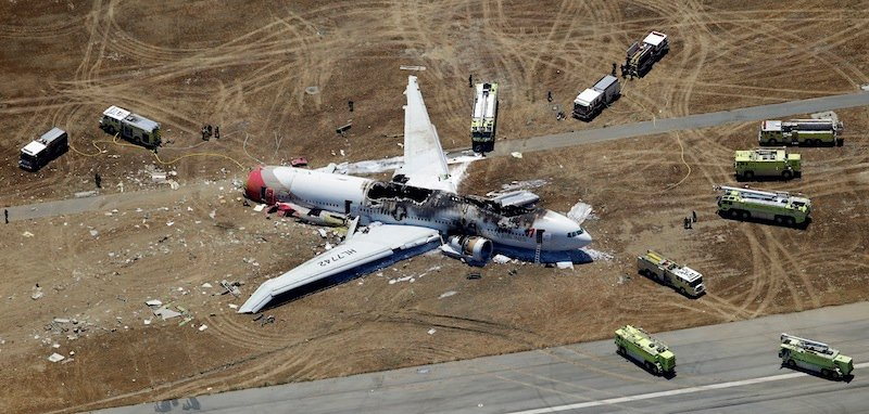 In this Saturday, July 6, 2013 aerial photo, the wreckage of Asiana Flight 214 lies on the ground after it crashed at the San Francisco International Airport, in San Francisco. The pilot at the controls of airliner had just 43 hours of flight time in the Boeing 777 and was landing one for the first time at San Francisco International. (AP Photo/Marcio Jose Sanchez)