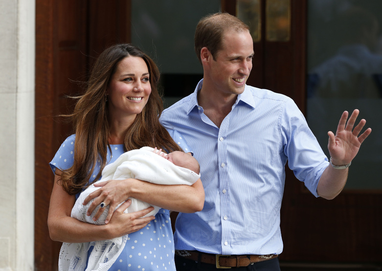 Britain's Prince William and Kate, Duchess of Cambridge, hold the newborn Prince of Cambridge on Tuesday as they pose for photographers outside St. Mary's Hospital in London where the Duchess gave birth Monday.