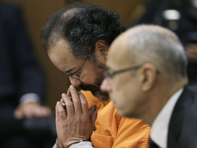 Ariel Castro looks down during court proceedings Friday in Cleveland. Defense attorney Jaye Schlachet is on the right.
