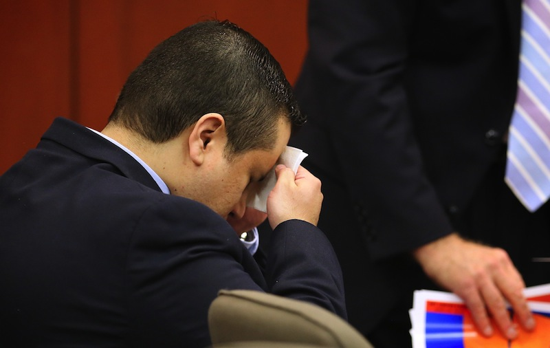 George Zimmerman wipes his face after arriving in the courtroom for his trial at the Seminole County Criminal Justice Center, in Sanford, Fla., Friday, July 12, 2013. Zimmerman is charged in the 2012 shooting death of unarmed teenager Trayvon Martin. (AP Photo/Orlando Sentinel, Joe Burbank, Pool)