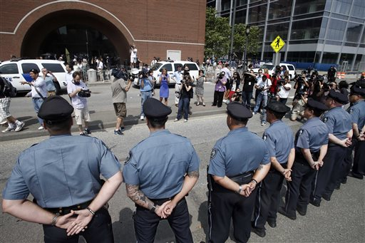 MIT police officers stand at attention outside the federal courthouse prior to arraignment for Boston Marathon bombing suspect Dzhokhar Tsarnaev on Wednesday in Boston. MIT officer Sean Collier was killed by the alleged suspects. The 19-year-old Tsarnaev has been charged with using a weapon of mass destruction, and could face the death penalty.