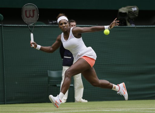 Serena Williams returns to Sabine Lisicki of Germany during a women's singles match at Wimbledon on Monday. (AP Photo/Alastair Grant)