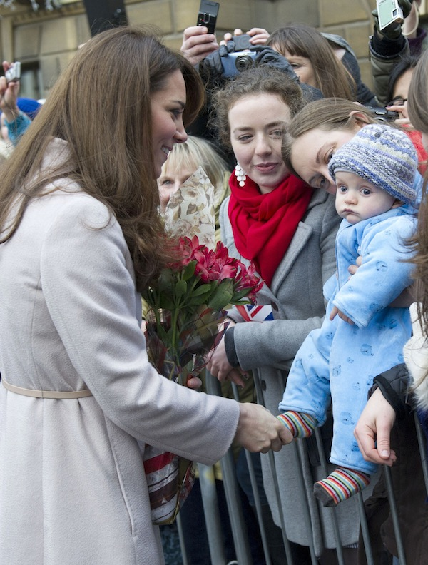 In this Wednesday Nov. 28, 2012 file photo Britain's Kate Duchess of Cambridge. left. meets with a young member of the public as she arrives at the Guildhall during a visit to Cambridge England. Prince William's wife Kate has been admitted to the hospital in early stages of labor it was announced on Monday July 22, 2013. (AP Photo/Arthur Edwards, File)
