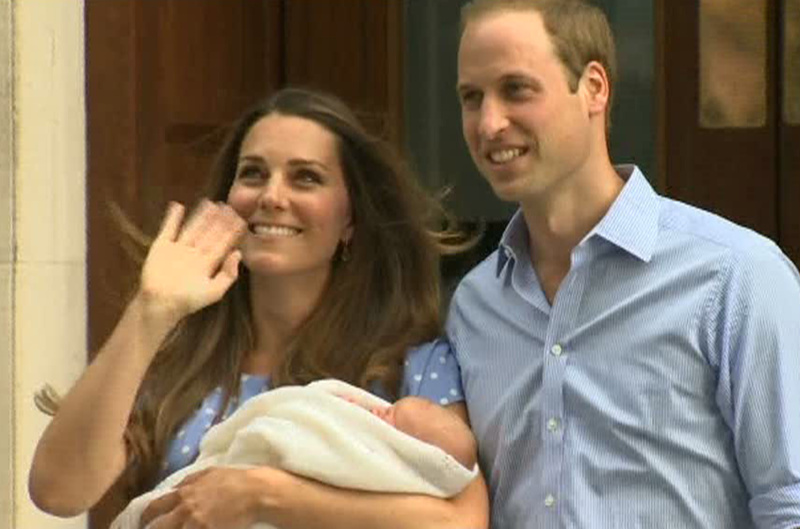 In this image from video, the Duke and Duchess of Cambridge leave St. Mary's Hospital in London on Tuesday carrying their newborn son into public view for the first time. The boy will be third in line to the British throne.
