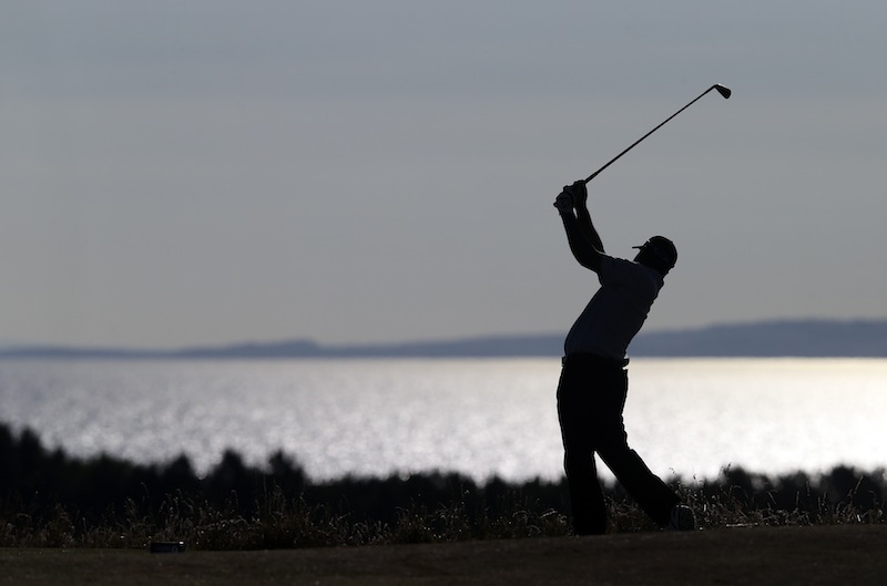Shiv Kapur of India plays a shot on the 12th hole during the first round of the British Open Golf Championship at Muirfield, Scotland, on Thursday.