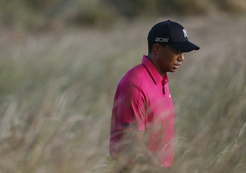 Tiger Woods of the US walks to the 4th fairway during a practice round for the British Open Golf Championship at Muirfield, Scotland, Tuesday July 16, 2013. (AP Photo/Alastair Grant)