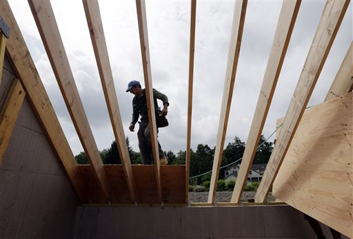 A worker installs a roof on a zero net energy home recently in New Paltz, N.Y. The latest confidence index, based on responses from 281 builders, points to continued improvement for new home construction, which remains a key source of growth for the economy.