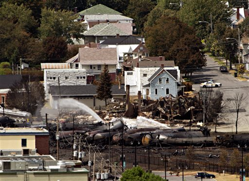 Wreckage is strewn through the downtown core in Lac-Megantic, Quebec, on Monday after a train derailed, igniting tanker cars carrying crude oil early Saturday.
