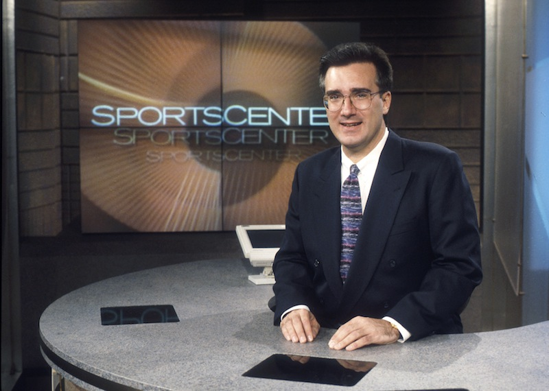 """In this photo taken Jan. 13, 1996, and provided by ESPN Images, ESPN on air personality Keith Olbermann poses for a photo on the """"SportsCenter"""" studio set in Bristol, Conn. Olbermann, who rose to prominence as a """"SportsCenter"""" anchor from 1992-97 before one of several contentious departures that have marked his career, is rejoining ESPN to host a late-night show, the network said Wednesday, July 17, 2013. (AP Photo/ESPN Images, Rick LaBranche) ESPN;Keith Olbermann;1996;historical;SportsCenter;set shots;set shot;historic;suit;tie;talent;host;posing"""