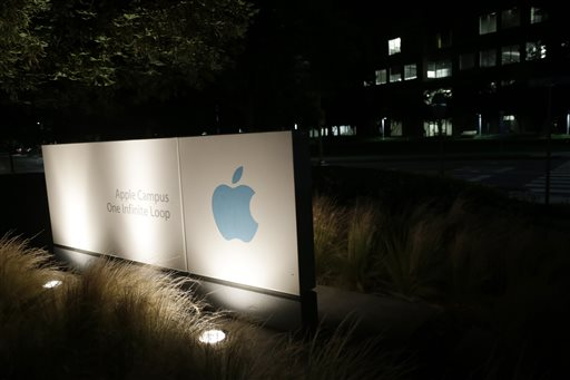 """A sign displays the Apple logo outside of the company's headquarters in Cupertino, Calif. A federal judge has ruled that Apple Inc. broke antitrust laws and conspired with publishers to raise electronic book prices, citing """"compelling evidence"""" from the words of the late Steve Jobs."""