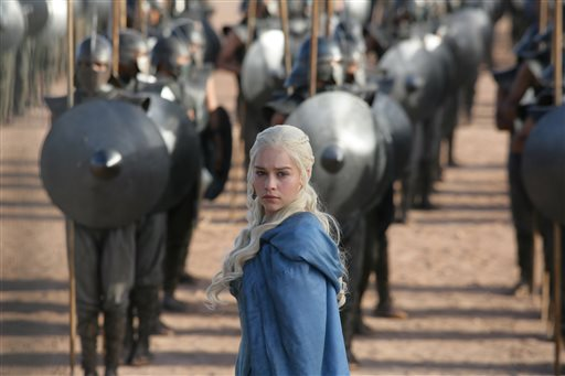 """This publicity image released by HBO shows Emilia Clarke in a scene from """"Game of Thrones."""" The program was nominated for an Emmy Award for outstanding drama series. Clarke was also nominated for best supporting actress."""