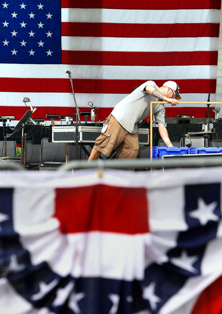 """Scott Trouwborst of Moonlighting Production Services sets up the sound on the stage where Don McLean and the Portland Symphony Orchestra will perform during the """"Stars and Stripes Spectacular,"""" Portland's Fourth of July fireworks and concert celebration on the Eastern Promenade in Portland on July 3, 2013."""