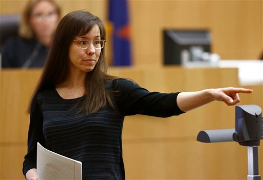 In this May 21, 2013, photo, Jodi Arias points to her family as a reason for the jury to give her life in prison instead of the death penalty, during the penalty phase of her murder trial at Maricopa County Superior Court in Phoenix. As she awaits a decision by prosecutors on the future of her murder case, Arias and her attorneys are returning to court Tuesday to ask the judge to throw out the jury's finding that made her eligible for the death penalty.