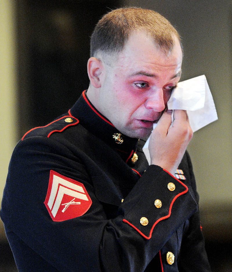 Clad in the dress uniform of the Marine Corps, Travis Lawler was sentenced to four years Monday, July 29, 2013 at Kennebec County Superior Court for driving drunk that that killed his sister and her boyfriend and seriously injured a passenger.